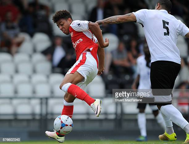 Donyell Malen of Arsenal holds off David Stephens of Borehamwood during a pre season friendly between Borehamwood and Arsenal at Meadow Park on July...