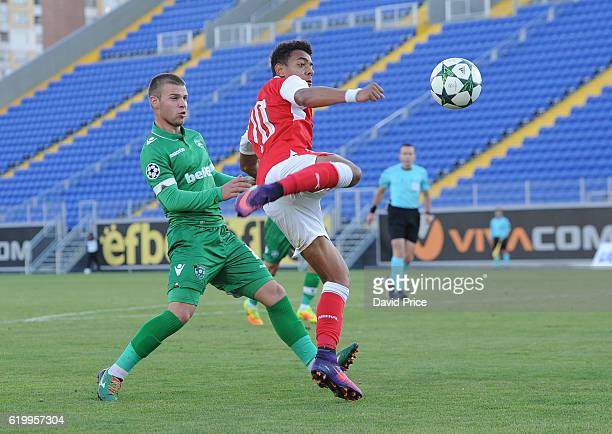 Donyell Malen of Arsenal is closed down by Milen Mladenov of Ludogorets during the match between PFC Ludogorets Ragrad and Arsenal in the UEFA Youth...