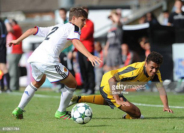 Donyell Malen of Arsenal is fouled by Veriano Vogrig of Basel during the UEFA Champions League match between Arsenal FC and FC Basel 1893 at Meadow...
