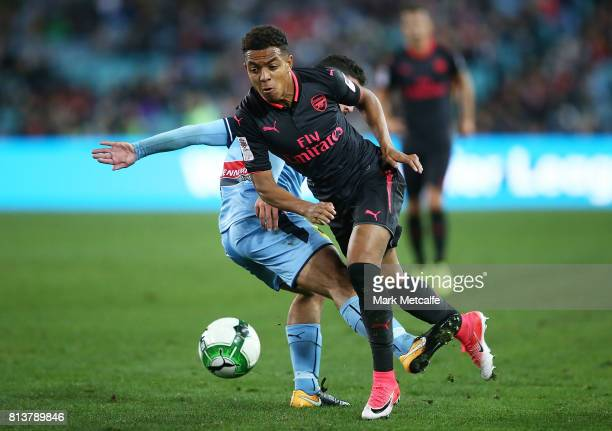 Donyell Malen of Arsenal is tackled during the match between Sydney FC and Arsenal FC at ANZ Stadium on July 13 2017 in Sydney Australia
