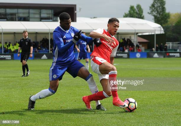 Donyell Malen of Arsenal shields the ball from Dujon Sterling of Chelsea during the U18 Premier League match between Chelsea and Arsenal at Chelsea...