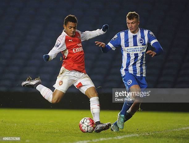 Donyell Malen of Arsenal takes on Ben Barclay of Brighton during the match between Brighton and Hove Albion U21 and Arsenal U21 at Amex Stadium on...