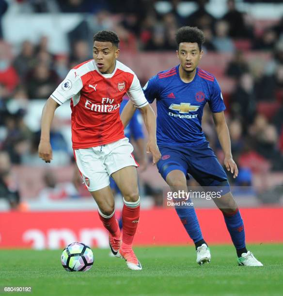 Donyell Malen of Arsenal takes on Cameron BorthwickJackson of Man Utd during the Premier League 2 match between Arsenal U23 and Manchester United U23...