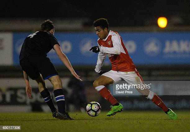 Donyell Malen of Arsenal takes on Charley Doyle of Blackburn during the Premier League match between Arsenal and Stoke City at Meadow Park on...