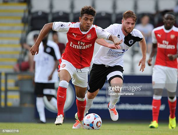 Donyell Malen of Arsenal takes on Conor Clifford of Borehamwood during a pre season friendly between Borehamwood and Arsenal at Meadow Park on July...