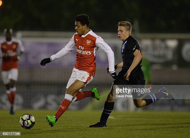Donyell Malen of Arsenal takes on Jack Evans of Blackburn during the Premier League match between Arsenal and Stoke City at Meadow Park on December...