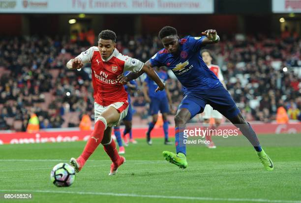 Donyell Malen of Arsenal takes on Matthew Olosunde of Man Utd during the Premier League 2 match between Arsenal U23 and Manchester United U23 at...