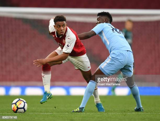 Donyell Malen of Arsenal takes on Taylor Richards of Man City during the Premier League 2 match between Arsenal and Manchester City at Emirates...