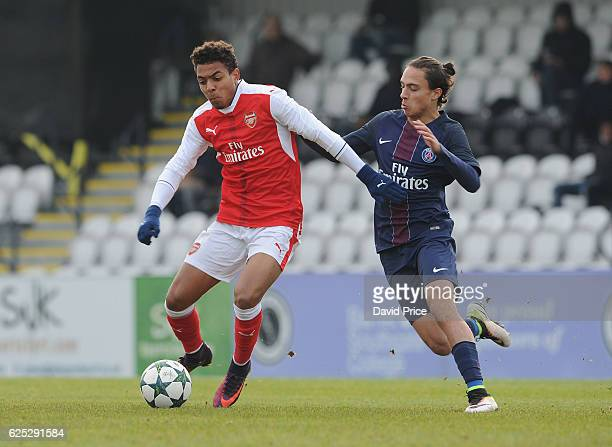 Donyell Malen of Arsenal takes on Theo Epailly of PSG during the UEFA Youth Champions League match between Arsenal and Paris Saint Germain at Meadow...