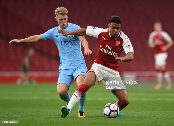 Donyell Malen of Arsenal under pressure from Matthew Smith of Manchester City during the match between Arsenal U23 and Manchester City U23 at...