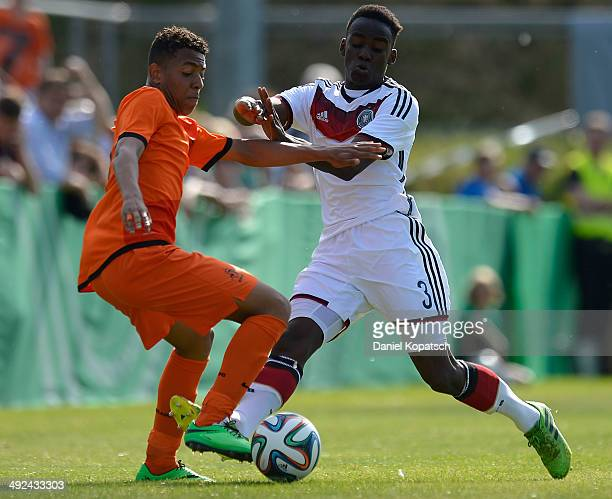 Donyell Malen of the Netherlands is challenged by Moody Chana Nya of Germany during the international friendly U15 match between Germany and...