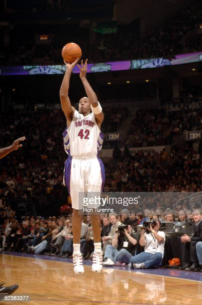 Donyell Marshall of the Toronto Raptors shoots a threepointer against the Philadelphia 76ers on March 13 2005 at the Air Canada Centre in Toronto...