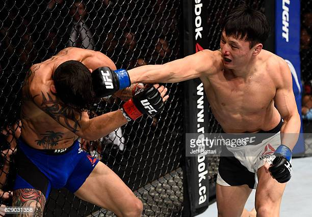 Dooho Choi of South Korea punches Cub Swanson in their featherweight bout during the UFC 206 event inside the Air Canada Centre on December 10 2016...