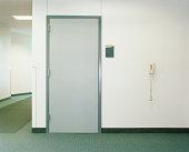 Door and telephone in building hallway