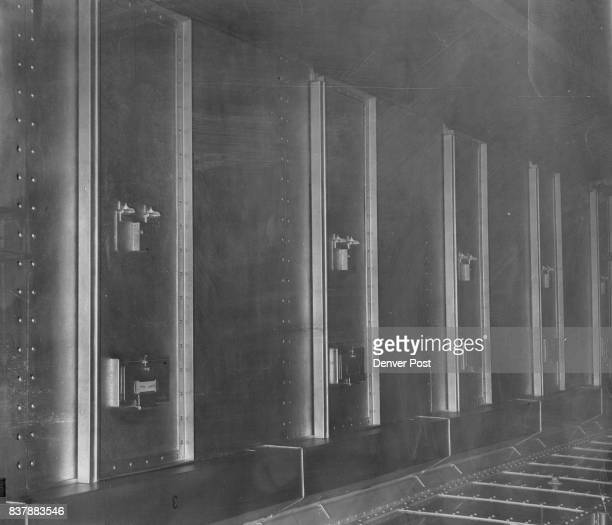 OCT 4 1951 door covers a small window The small door near the bottom is used for feeding prisoners Interior of one of the cells is shown at right The...
