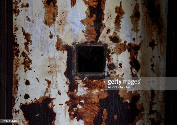 A door is seen in one of the buildings of the The Ellis Island Hospital August 5 a 750bed facility which treated over 12 million patients and where...