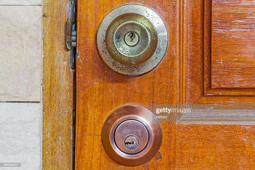 Door Knob And Key Hole Locker Stock Photo Thinkstock