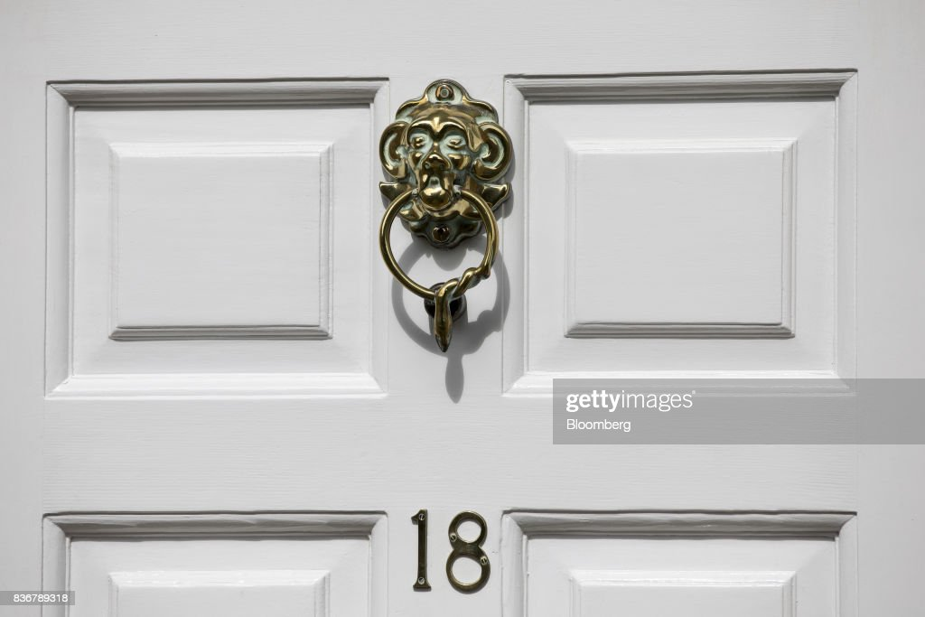 A door knocker hangs on the front door of a house on a suburban street in Bath, U.K. on Monday, Aug. 21, 2017. U.K. property prices stagnated in July as a slump in London values spread to neighboring areas, according to theRoyal Institution of Chartered Surveyors. Photographer: Jason Alden/Bloomberg via Getty Images