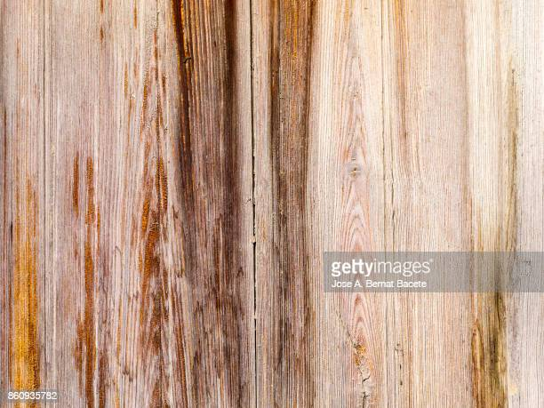 Door of ancient wood damaged and spoiled in the time with nails and locks metallic