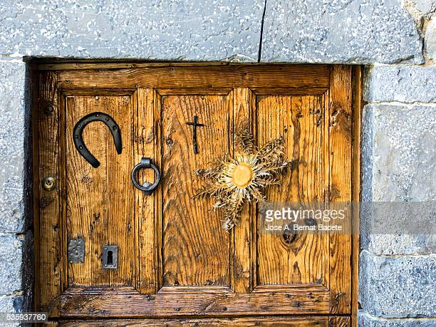 Door of wood of an ancient house of people with metallic ornaments