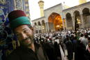 A door warder in the Imam Hussein mosque smiles April 21 in Karbala Iraq Millions of Shia Muslims have flocked to the holy city of Karbala for a...