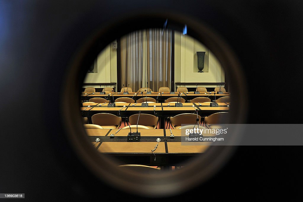 A door window shows a conference room in Geneva's Palais des Nations on January 12, 2012 in Geneva, Switzerland. The European Headquarters of the United Nations, with its oldest sections built between 1929 and 1938 and originally known as the League of Nations, is studying the work requested for the complex restoration to upgrade its infrastructure and lower its carbon footprint while maintaining its historical and cultural value. The work, which would not begin for several years, could cost more than USD 1 billion.