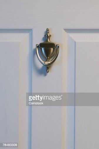 Door with knocker