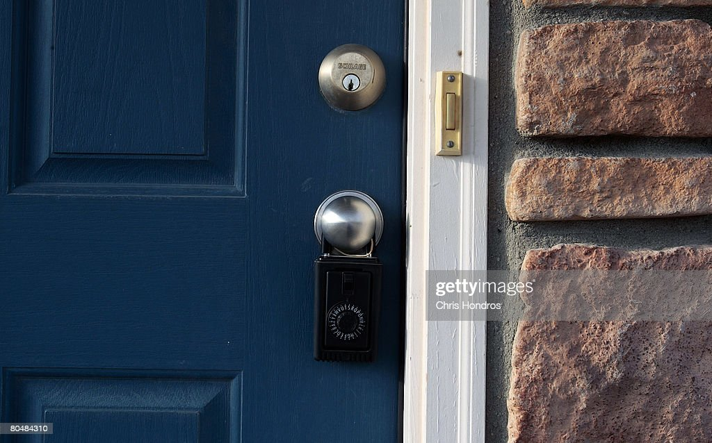 A doorknob of a home for sale is secured with a realtor's lock in a neighborhood full of other homes for sale April 2, 2008 in Henderson, Colorado. The Denver metropolitan area has been hard-hit by the housing downturn, with officials estimating that as many as 11,000 properties might go into foreclosure this year.