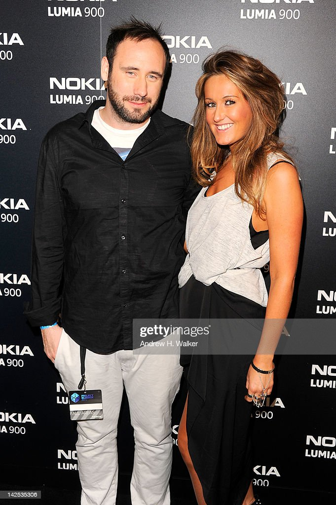 DJ Doorly (L) and guest arrive at Times Square to watch Nicki Minaj team up with Nokia to perform live for the launch of the Windows Phone-based Nokia Lumia 900 in North America at R Lounge at the Renaissance New York Times Square Hotel on April 6, 2012 in New York City. Tens of thousands of people watched as a building appeared to 'come alive' in the heart of New York City. Nine of Times Square's famous electronic screens captured the reaction of the crowds. The entire show was filmed as a backdrop for the music video for the exclusive Nokia Lumia 900 remix of Minaj's hit 'Starships'. The Windows Phone-based Nokia Lumia 900 will be available in unique and eye-catching cyan blue and a matte black with a new high-gloss white version on sale later this month. To watch more of the amazing event go to www.facebook.com/nokiaus