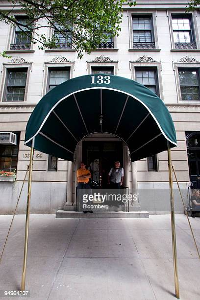 A doorman and superintendent left who declined to be identified stand outside 133 East 64th Street a building that houses the penthouse apartment...
