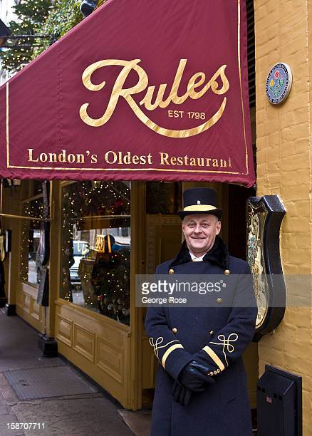 A doorman at Rules one of the oldest restaurant in town greets visitors on December 6 in London England Central London captures the Christmas holiday...