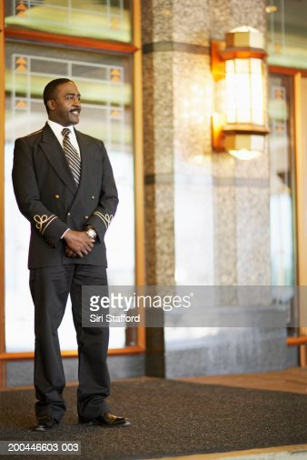 Doorman standing outside hotel : Stock Photo