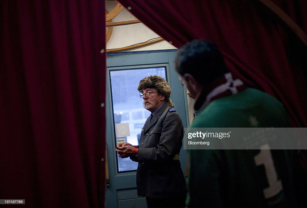 A doorman stands at the door to the VIP tent at the annual Klosters Snow Polo event in Klosters, Switzerland, on Friday, Jan. 20, 2012. German Chancellor Angela Merkel will open next week's World Economic Forum in Davos, Switzerland, which will be attended by policy makers and business leaders including U.S. Treasury Secretary Timothy F. Geithner. Photographer: Scott Eells/Bloomberg via Getty Images