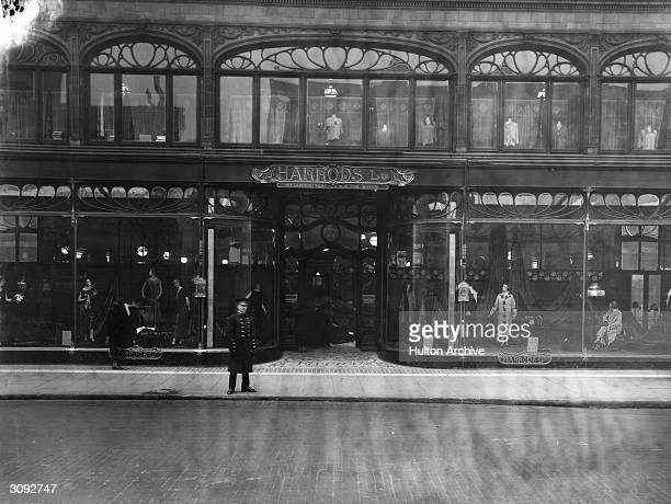 A doorman stands at the entrance to Harrods the famous London department store in Knightsbridge