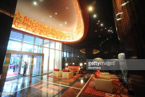 A doorman stands at the main entrance during the grand opening of the Mandarin Oriental hotel at the MGM Mirage CityCenter in Las Vegas Nevada US on...