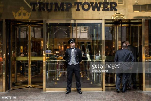 A doorman stands in front of an entrance to Trump Tower March 7 2017 in New York City In a series of tweets on Saturday morning President Donald...