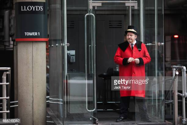 A doorman stands outside the Lloyd's building home of the world's largest insurance market Lloyd's of London on March 27 2017 in London England...