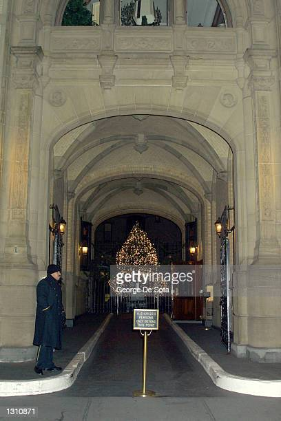 A doorman stands watch December 7 2000 at the entrance to the famous Dakota apartment building in New York City where John Lennon was shot and killed...