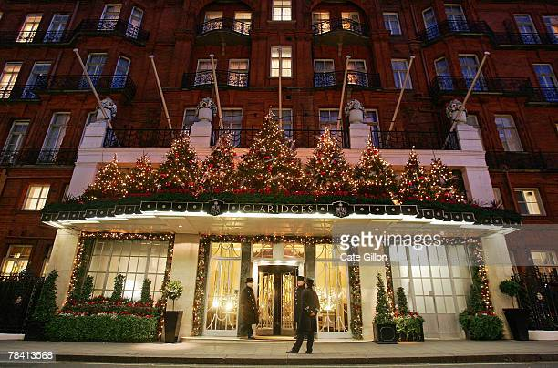 Doormen stand on duty in front of Claridges Hotel which is lit up for Christmas on December 12 2007 in London