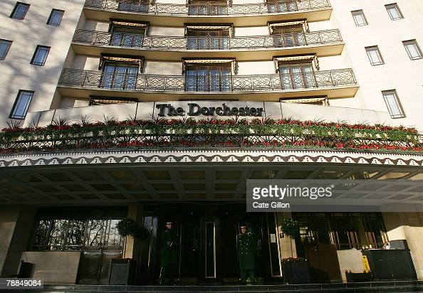 Doormen wait to assist residents at the entrance of The Dorchester Hotel on January 9 2008 in London Located on Park Lane in the heart of Mayfair The...