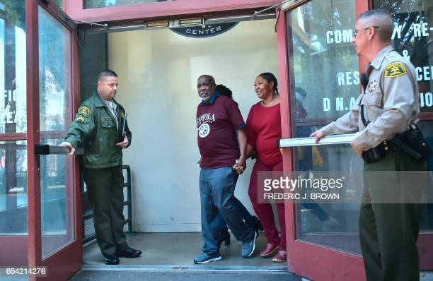 Doors are opened for Andrew Wilson to step out of the Men's Central Jail in Los Angeles California on March 16 accompanied by his sister Gwen and...