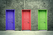 Colorful doors on the concrete wall