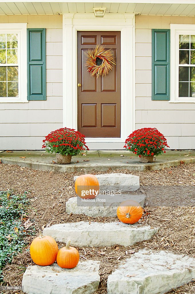 Doorstep of a residential home decorated for Fall.