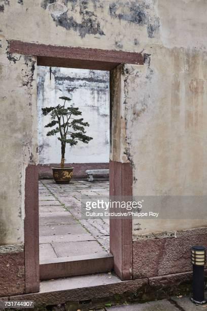 Doorway and courtyard in Baoguo temple complex, Ningbo, Zhejiang, China
