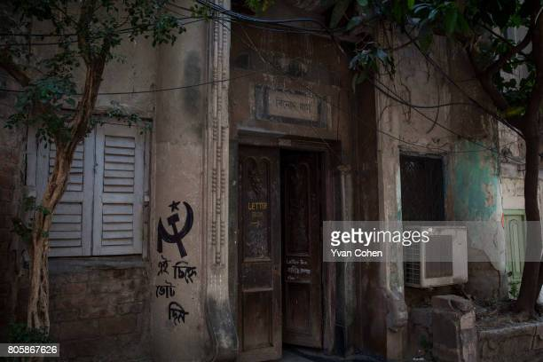A doorway in the older northern quarter of Kolkata The hammer and sickle emblem is a reminder of the long years that West Bengal was under the rule...