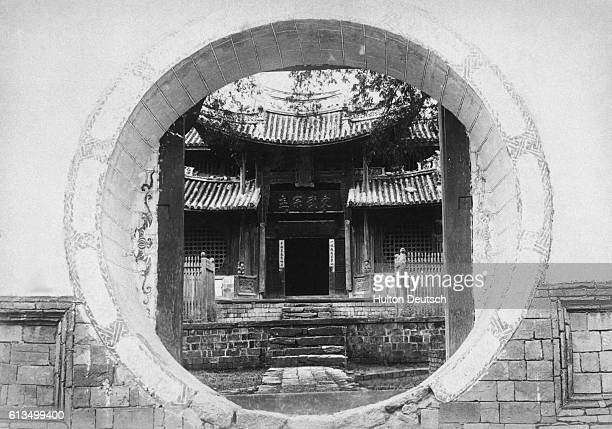 Doorway Of A Chinese Temple In Bhamo The entrance is a circular one through a massive stone wall 18 or 20 ft high It is closed by heavy teak doors...