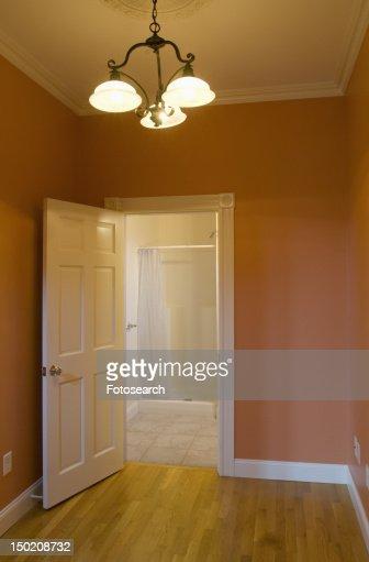 Empty Apartment Bathroom interior empty apartment with doorway to kitchen stock photo