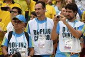 Doping controllers attend the third place playoff football match between Brazil and Netherlands during the 2014 FIFA World Cup at the National...