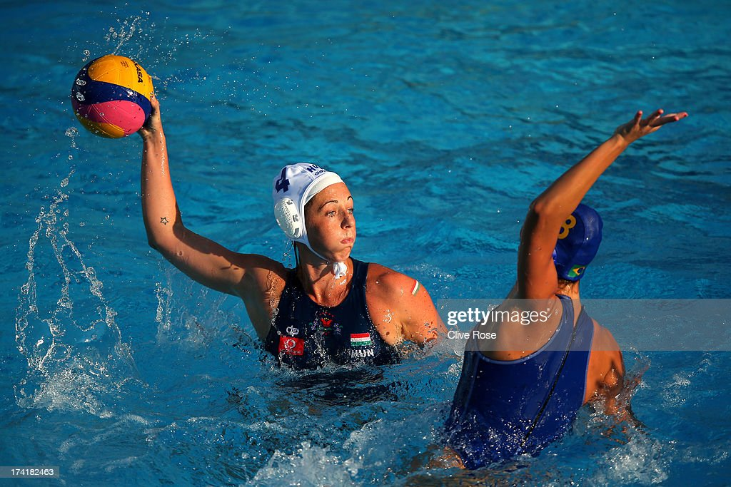 Dora Agnes Kisteleki of Hungary looks to pass the ball under pressure from Izabella Chiappini of Brazil in the Women's Water Polo first preliminary round match between Hungary and Brazil during Day Two of the 15th FINA World Championships at Piscines Bernat Picornell on July 21, 2013 in Barcelona, Spain.