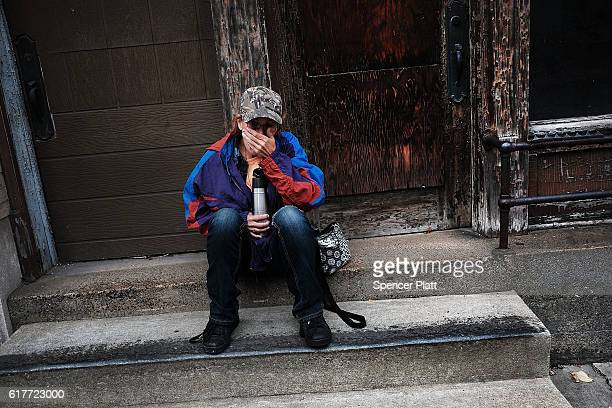 Dora Reynolds who is currently unemployed sits along a road downtown on October 24 2016 in East Liverpool Ohio East Liverpool once prosperous from...